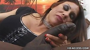 Mature MILF takes on big glowering cock