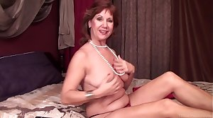 Mature lady Linger playing with shaved pussy