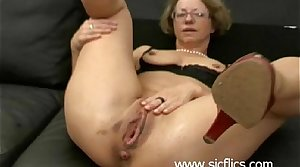 Mature slut gets brutally left side fucked back her unrestrained pussy by two merciless brutes