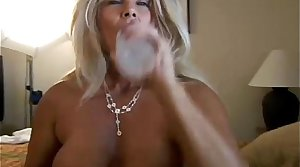 Roxy is a horny cougar who loves to fuck younger guys