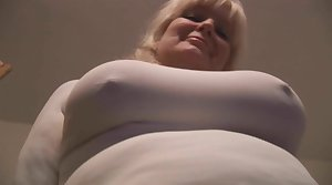 Busty beloved blonde English Milf stripping