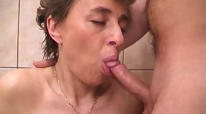 Busty granny sucks grandpa's tiny cock